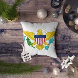 Happy New Year tag with Virgin Islands United States flag on pillow. Christmas decoration concept on wooden table with lovely vector illustration