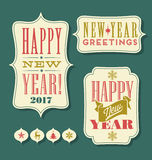 Happy New Year 2017 tags vintage typography design elements. And icons Stock Images