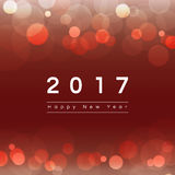 2017 Happy New Year. Text on bokeh red abstract background Vector Illustration