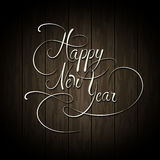 Happy New Year text. Calligraphy type on wooden Stock Photos
