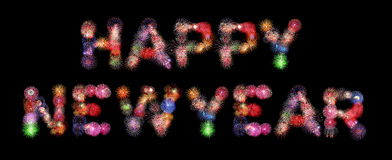 Happy new year text colorful fireworks. Isolated on black background Stock Images