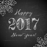 Happy 2017 New Year text design. On black chalkboard. Vector greeting illustration with numbers and snowflakes Royalty Free Stock Photo