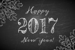 Happy 2017 New Year text design. On black chalkboard. Vector greeting illustration with numbers and snowflakes Stock Images
