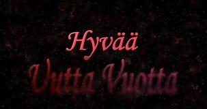 Happy New Year text in Finnish Hyvaa uutta vuotta turns to dus. T from bottom on black background Stock Photos