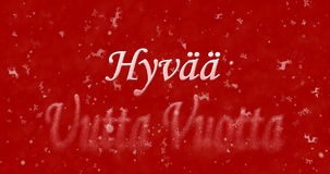 Happy New Year text in Finnish Hyvaa uutta vuotta turns to dus Royalty Free Stock Photography