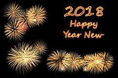 Happy new year 2018 text of fire text and fireworks. Inscription the fire letters Happy new year 2018 and flashes of festive gold colored fireworks salute on a Stock Image