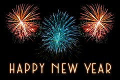 Happy New Year text with fireworks background. Happy New Year text with colorful fireworks background Royalty Free Stock Photo