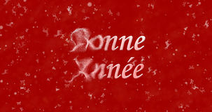 Happy New Year text in French Bonne annee turns to dust from l Royalty Free Stock Photo