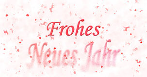 Happy New Year text in German Frohes neues Jahr turns to dust Stock Photo