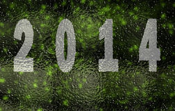 Happy new year 2014. Text with glass reflection and snow on green background Stock Images