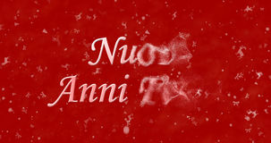 Happy New Year text in Italian Nuovi anni felici turns to dust. From right on red background Stock Illustration
