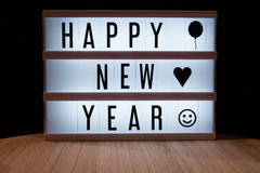 Happy new year. `Happy new year` text in lightbox Royalty Free Stock Image
