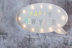 Happy New Year text in lightbox on grey minimalistic background. Copy space royalty free stock photos