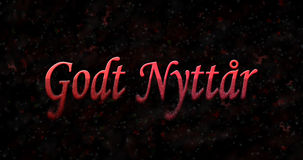 Happy New Year text in Norwegian Godt nyttar turns to dust fro. M bottom on black background Royalty Free Stock Photography