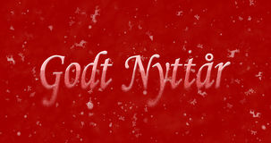 Happy New Year text in Norwegian Godt nyttar turns to dust fro Royalty Free Stock Photos