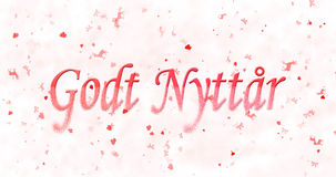 Happy New Year text in Norwegian Godt nyttar turns to dust fro. M bottom on white background Royalty Free Stock Photos