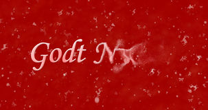 Happy New Year text in Norwegian Godt nyttar turns to dust fro. M right on red background Royalty Free Illustration