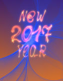 Happy new year 2017  text and numbers written with flame light on bright abstract universe background.  Stock Image