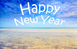 Happy New Year text over seascape Royalty Free Stock Image