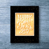 Happy New Year 2017 text. Party flyer template. Happy New Year 2017 typographic text in golden frame on black background. Vector greeting card template with stock illustration