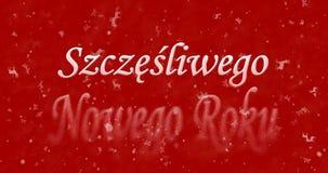 Happy New Year text in Polish Szczesliwego Nowego Roku turns t. O dust from bottom on red background Stock Photos