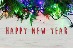 Happy new year text sign on christmas frame of garland lights on Royalty Free Stock Photography