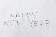 Happy new year text on snow Royalty Free Stock Images