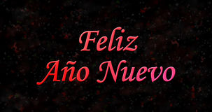 Happy New Year text in Spanish Feliz ano nuevo on black backgr. Ound Stock Photography