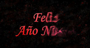 Happy New Year text in Spanish Feliz ano nuevo turns to dust f. Rom right on black background Royalty Free Illustration