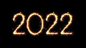 Happy New Year 2022 Text Sparkler Glitter Sparks Firework Loop Animation. Happy New Year 2022 Text Sparkler Writing With Glitter Sparks Particles Firework on stock footage