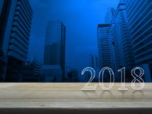 Happy new year 2018 text on wooden table. Over modern office city tower Stock Photography
