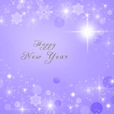 Happy New Year text written on purple bright sparkly winter background.  Royalty Free Stock Photography