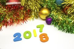 2018 happy new year tinsel and Christmas balls decoration background Stock Photos