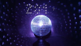 Happy New Year, 2016 to 2017, Disco Ball. 2016 in sparkling numbers fading into 2017 with Happy New Year greeting against rotating blue disco ball stock video