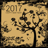 Happy New Year - 2017. Happy tree with black roses on a golden grungy background with New Year numerals Royalty Free Stock Photography