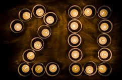 Twenty made of candles. Happy new year 2020 - A twenty made of candles in little glasses on a piece of tulle Stock Photo