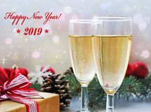 Two glasses of champagne, gift and Christmas decorations stock photo