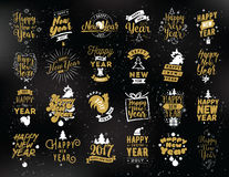 Happy New Year typographic emblems set. Happy New Year 2017 typographic emblems set. Vector logo design. Black and gold. Usable for banners, greeting cards Vector Illustration