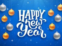 Happy New Year typography on vector card. Happy New Year typographic text on blue background with sparkles and colorful hanging balls. Vector illustration for Royalty Free Stock Image