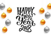 Happy New Year typography on vector card. Happy New Year 2018 typographic text on white background with gold and silver hanging christmas balls. Vector Stock Images