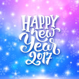 Happy New Year typography on festive background. Happy New Year 2017 greeting card with magic light, stars and snowflakes on colorful background. Vector design vector illustration