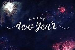 Happy New Year Typography with Fireworks in Night Sky. Happy New Year Celebration Typography with Colorful Fireworks in Dark Night Sky, Horizontal royalty free stock photo