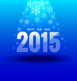 Happy new year 2015 under light. On blue background Royalty Free Stock Photo