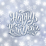 Happy New Year 2016 vector greeting card. Happy New Year 2016 greeting card design. Blurred background with snowflakes and white hand lettering inscription Happy Royalty Free Stock Images