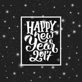 Happy New Year 2017 vector greeting card design. Happy New Year 2017 typography text in frame on black starry background. Greeting card design with hand Stock Images
