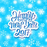 Happy New Year 2017 vector greeting card. Happy New Year 2017 text on white paper label above winter background with snowflakes. Vector card design with holiday Stock Photography