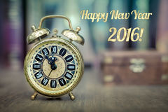 Happy New Year 2016! Vintage alarm clock showing five to twelve. Royalty Free Stock Photography
