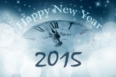 Happy new year with watch close to midnight Royalty Free Stock Image