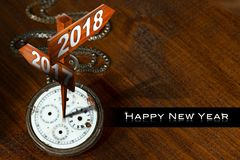 Happy New Year 2018 - Watch with Signs. Happy New Year 2018 - Old pocket watch with two wooden signs with arrows and the years 2017 and 2018 vector illustration