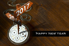 Happy New Year 2017 - Watch with Signs. Happy New Year 2017 - Old pocket watch with two wooden signs with arrows and the years 2016 and 2017 Stock Photo